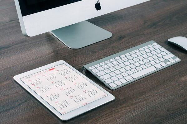 Calendar on iPad with iMac computer on desk