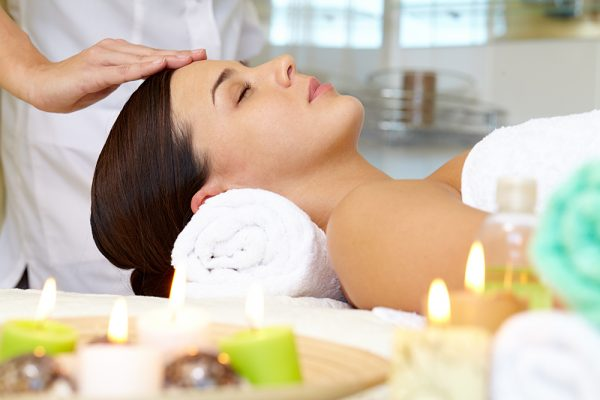 Woman getting a facial massage in a spa