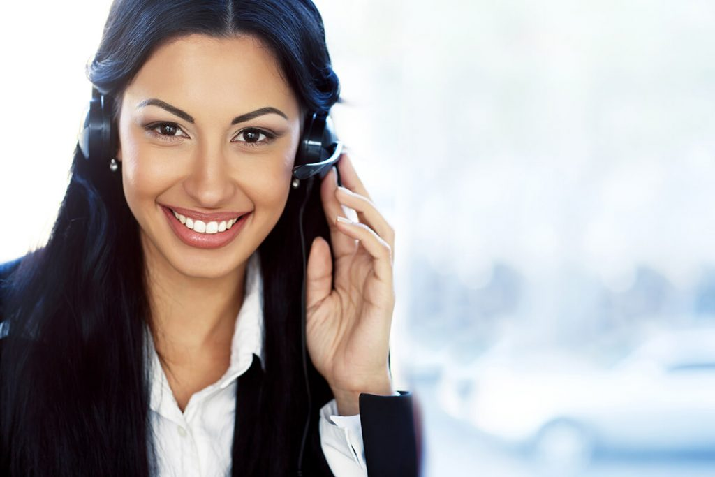 Woman on the support team ready to help on phone call or live chat